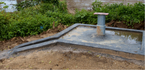 A bore well with its finishing complete - all that is left is for the hand-pump to be placed on top!
